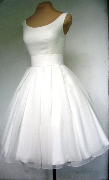 A beautiful ivory 50s inspired dress boat neck, and darling pleated skirt for bridesmaids in different colour