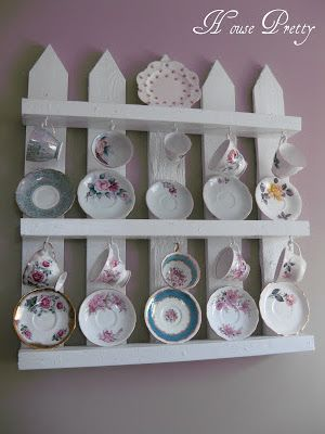 """DIY """"White Picket Fence"""" Pallet Shelf.  (The directions are a bit sketchy but the picture may be enough).  I think it's doable but it's up to you!"""