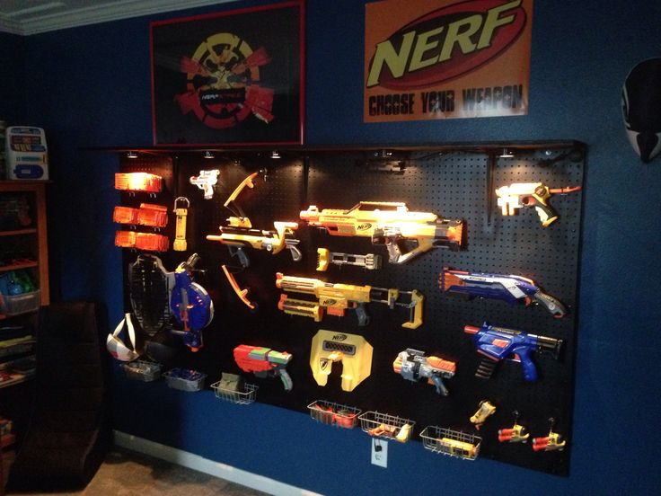 Peg board wall for nerf guns... Kohen is getting one of these ASAP... his room is full of Nerf Paraphernalia