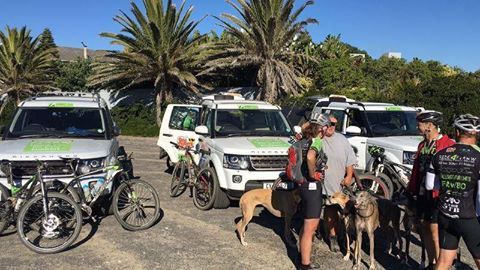 And they have arrived! :-) WELL DONE to all the riders and support team folks who braved the loooong trek from Oudtshoorn to Melkbos. You are total rock stars! :-)  (Pictured are some of the riders in front of the sponsored support vehicles, being congratulated by FAW supporter, Karen, and her rescued greyhounds.)