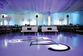 Floral Elements ostrich feathers and florals  Custom Dance Floor by @EVENTS BY EMMA and Draping by Planned Perfectly