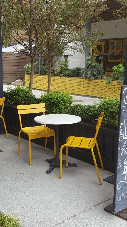 Bread & Butterfly Restaurant, Atlanta, GA - Fermob Luxembourg Chairs Honey