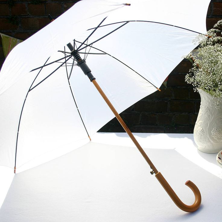 wedding umbrella with wooden handle by the brolly shop | notonthehighstreet.com
