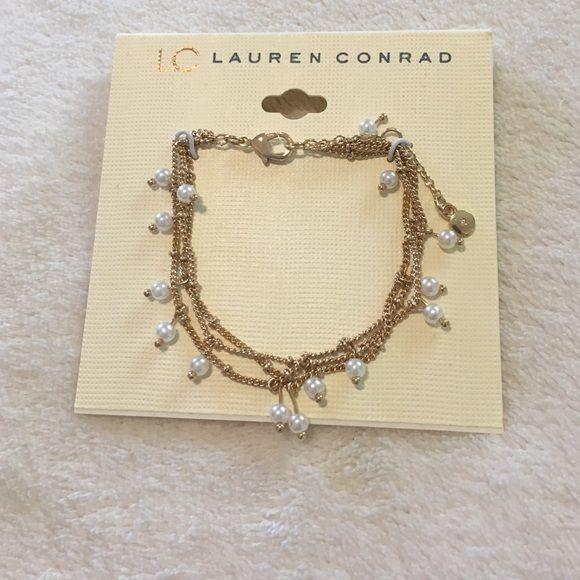 NWT Lauren Conrad Gold Bracelet Brand New Lauren Conrad gold bracelet with pearl white beads. LC Lauren Conrad Jewelry Bracelets