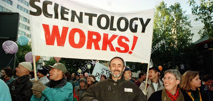 Scientology members promoting the religious organization. These members are spreading the word about Scientology and are encouraging individuals to join.
