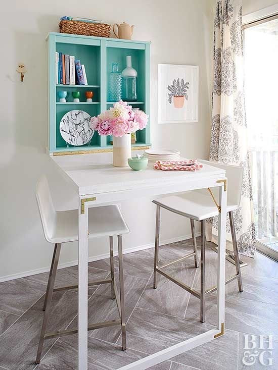 If your small kitchen lacks dining space, get creative and turn a wall display into functional furniture.