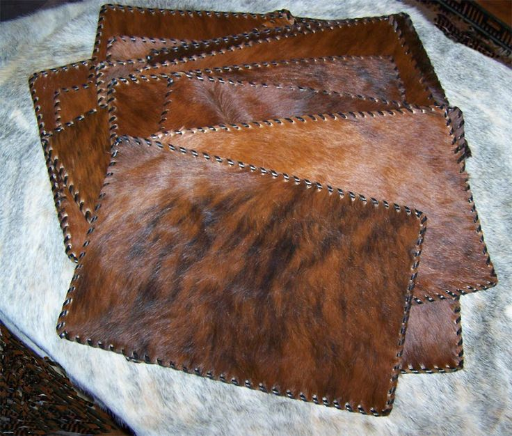 Leather Cowhide Placemat (1), plain b/w   Dress the table up with these handcrafted leather cowhide mats. Placemat has plain cowhide on the...