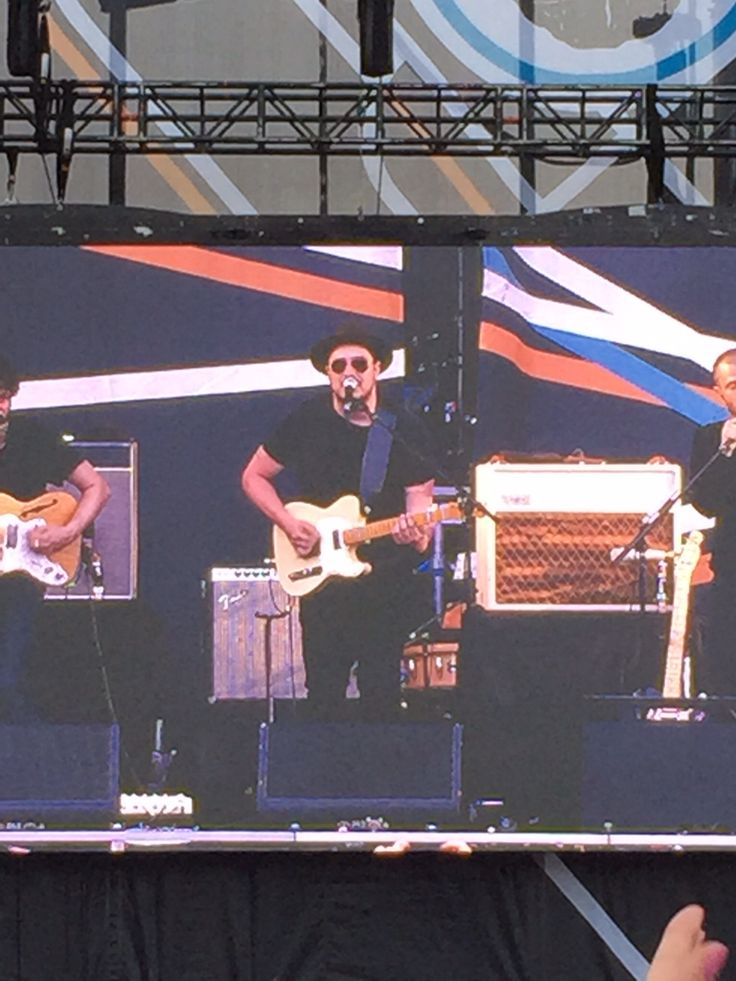 Marcus Mumford performing with the Macabees at Niagara on the lake concert Canada June 2015