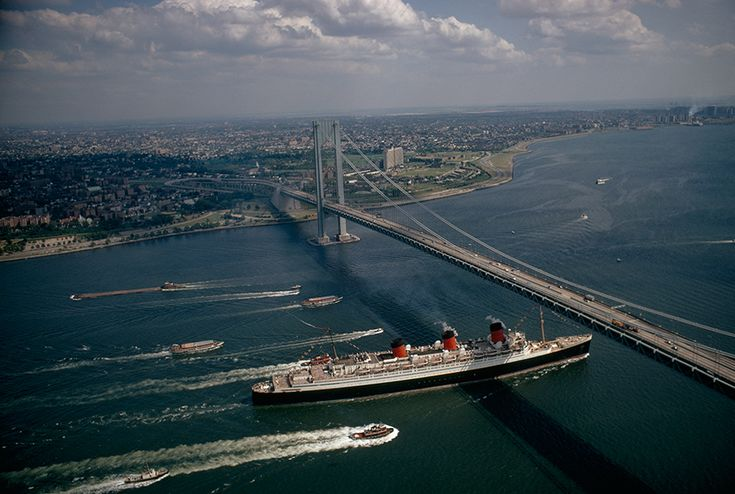 A cruise ship and other boats passing beneath a bridge, 1968.Photograph by James P. Blair, National Geographic Creative