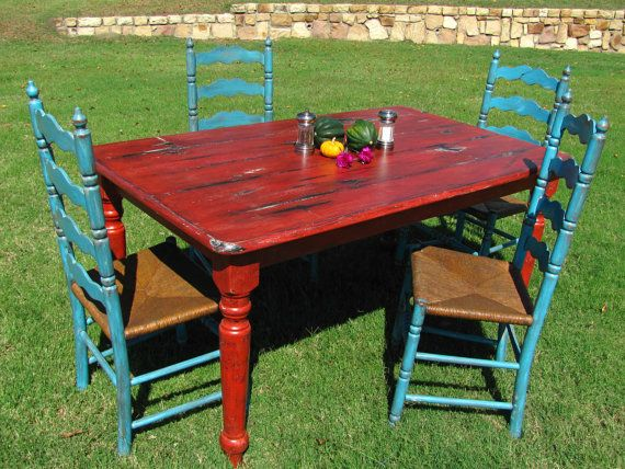 I like this rustic red table.    Shabby Chic Upcycled Farm House Table with by thevintagerefinery, $475.00