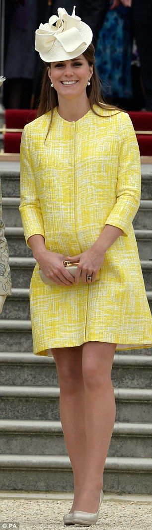 Sunny delight! Kate brightens up the Buckingham Palace Garden Party in a canary yellow coat.