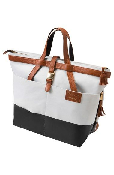 Free shipping and returns on Quinny x Rachel Zoe 'Jet Set' Canvas Diaper Bag at Nordstrom.com. A practical yet chic diaper bag with a special-edition design is made in partnership with designer Rachel Zoe and inspired by the jetsetter lifestyle, paying homage to luxe vintage leather luggage. Gorgeous cognac leather and chunky goldtone hardware add an opulent look and perfectly complement the chic black-and-white fabric. The convertible straps allow the style to be worn over the should...