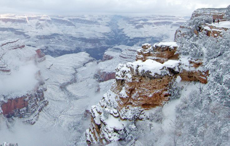 Northern Arizona received widespread snowfall totals of over four inches on New Year's Eve and Day. -- A snowy view from the South Rim Historic District of the Grand Canyon on January 1, 2015. (Michael Quinn/National Park Service via Flickr)
