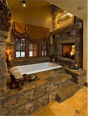 Amazing Stone bath with fireplace.  I LOVE stone inside.