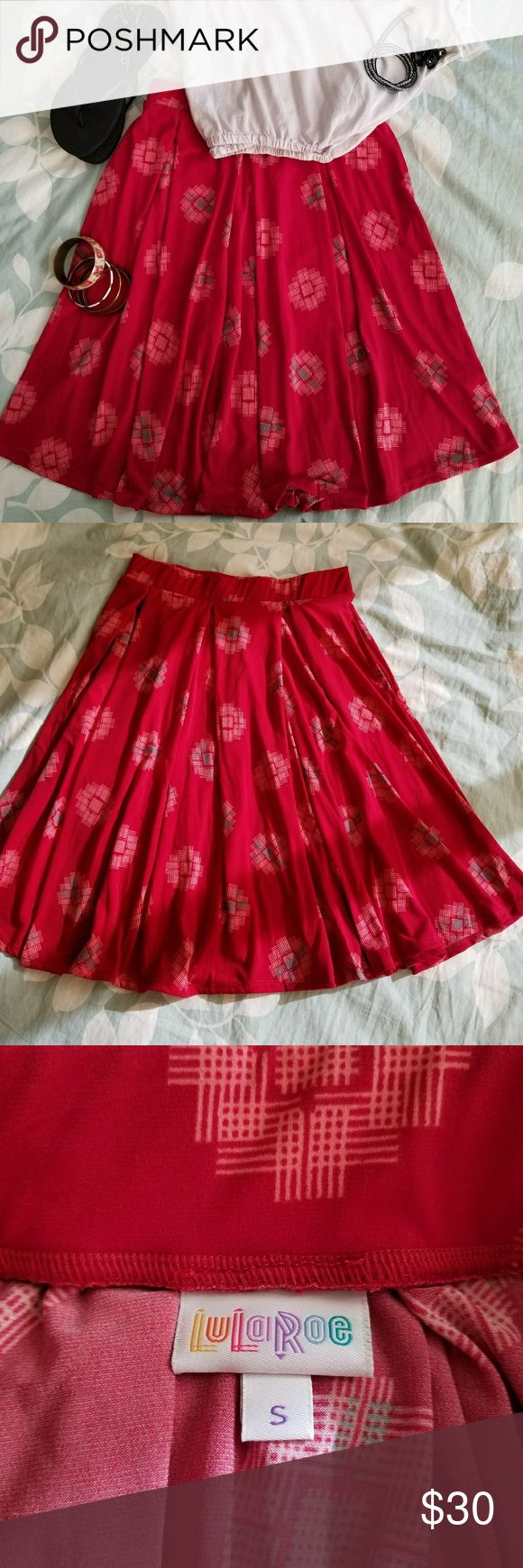 LuLaRoe Red Print Madison Skirt Soft, silky, red print LuLaRoe Madison skirt in EUC, perfect condition with no flaws or defects. I love the pockets on this one! Deep enough to carry your keys and a smart phone to make your busy life a little more hands-free. This bright versatile skirt can be paired with a plain white T-shirt and sandals for a casual day running errands or dressed up with gold jewelry, some heels, and a little black cardigan for a night out. LuLaRoe Skirts Midi
