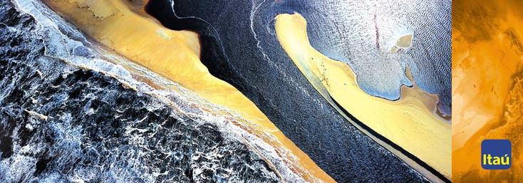 Capa de talão de cheques Itaú (agência DPZ, 2000). Fotografia Aerea do mar e falésia.                                                                                                                                                      Mais