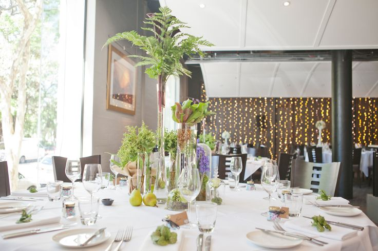 gorgeous green botanical table arrangement at Restaurant Two by Stem Design