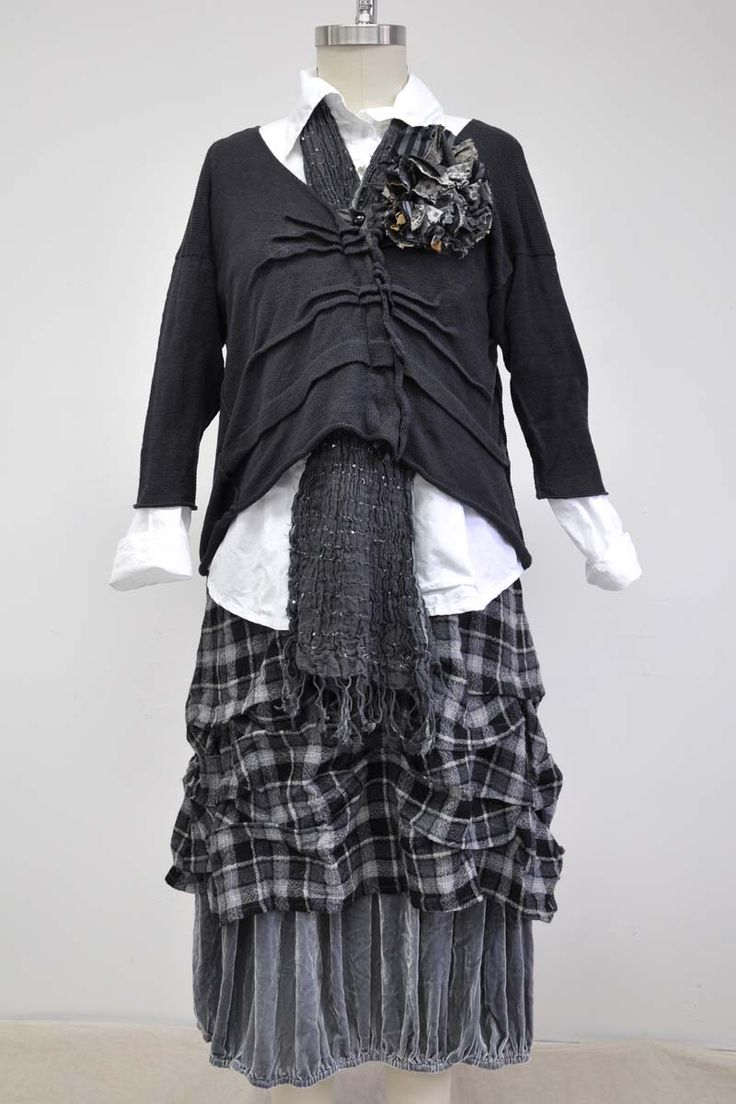 Features:    Lovely slip   Knee length   Large wave tucks at bottom   Side ties   100% Plaid Wool, Nickel/Cream   Fits sizes 2-16