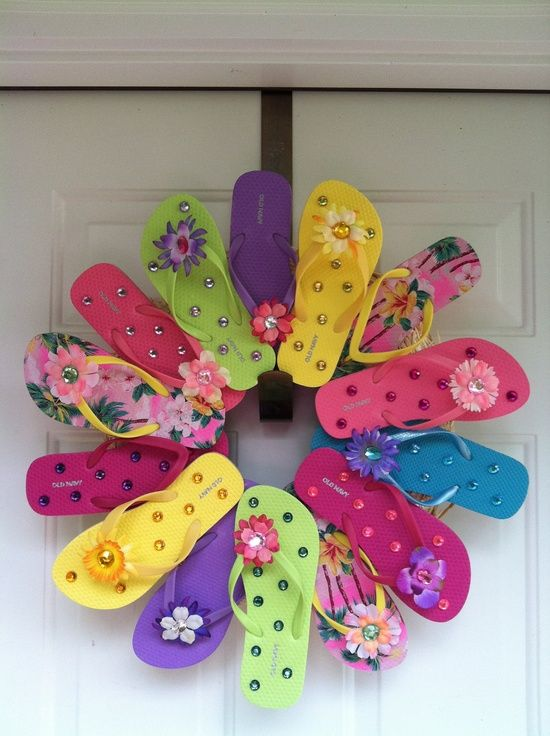 buy flipflops at the dollar store, bling them up, then make a wreath for summer...not your ordinary summer wreath but also could be cute to announce a party at your house, from a picnic to a kid's b-day. What a cute way to decorate your door1
