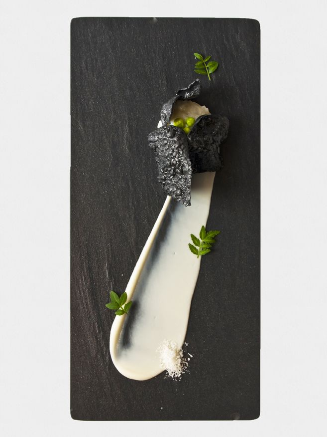 Japanese squid risotto with charcoal rice crisp, cauliflower puree and sugar peas