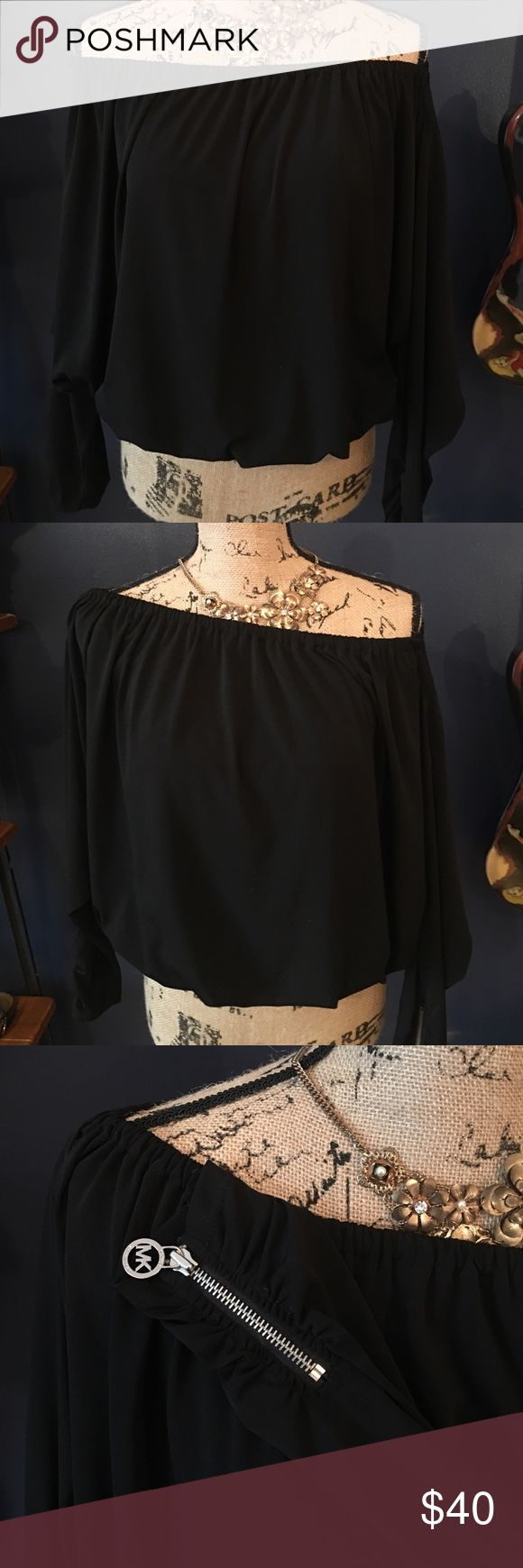 Michael Kors slouchy banded off shoulders blouse Michael Kors slouchy banded off shoulders blouse polyester and spandex. Super cute worn off one shoulder or both. Zipper cuff with silver MK zipper pulls. KORS Michael Kors Tops Blouses