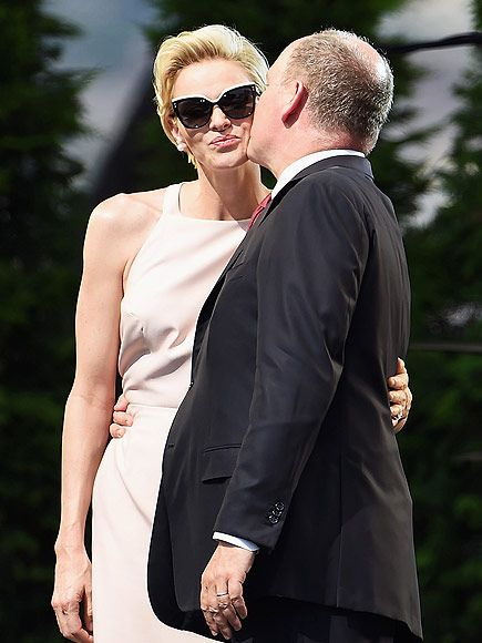 Star Tracks: Monday, July 13, 2015 | KISS A PRINCE | Prince Albert kisses wife Princess Charlene at his 10th anniversary on the throne celebrations in Monaco on Saturday.