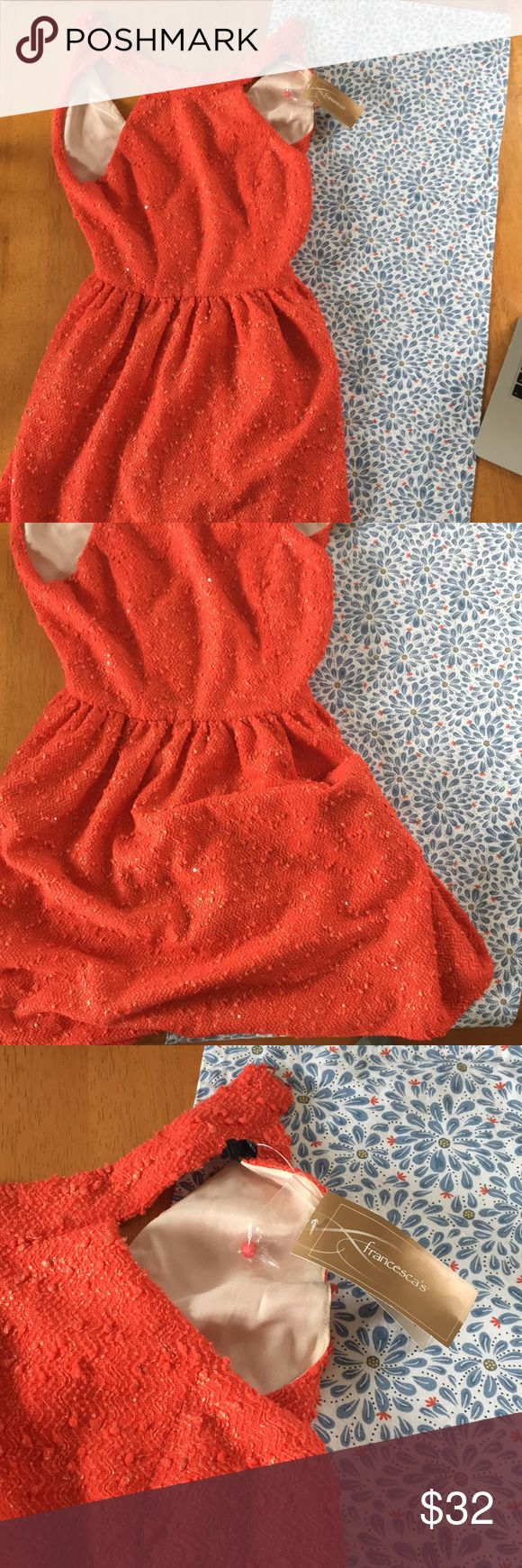 NWT Orange Semi-Formal Dress Sparkly orange dress with wavy golden pattern. Falls just above the knee, harness top that buttons in the back. Very cute! Too big on me though. Bought from Francesca's.  Bundle and save on shipping! Offers encouraged! Francesca's Collections Dresses