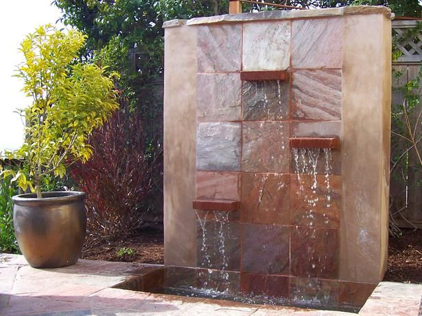 Outdoor Ponds, Water Features and Water Gardens: Lazar Landscape created this modern waterfall to bring a sculptural element into the garden. It can be viewed from the main level of the house, which is a flight above the garden. From DIYnetwork.com