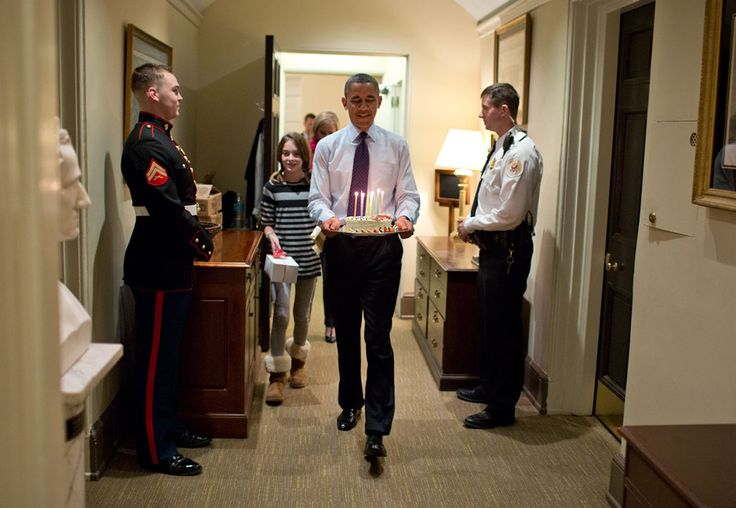 "2013: A Year in Photos -- Dec 2 -- ""Joined by Chief of Staff Denis McDonough's daughter, the President carries a birthday cake to surprise McDonough in his West Wing office."" (Official White House Photo by Pete Souza)"