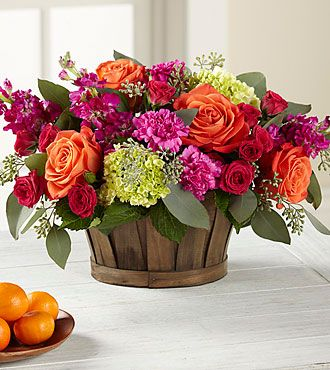 """Like the basket.  Different flowers though. Nice size for 72"""" round tables. The FTD® New Sunrise™ Bouquet 11""""Hx14""""W $70"""