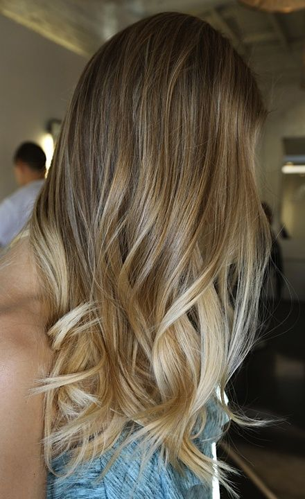 Here's one of the best ombres I've ever seen. And I'll tell you why. Not only is the base color of her hair, natural or not, it is rich and vibrant and slowly and seamlessly melds into the gently brightening pale blonde. Let me add further that not all of the underbelly of the hair has been lightened. Only particular peekaboo sections have been carefully crafted.