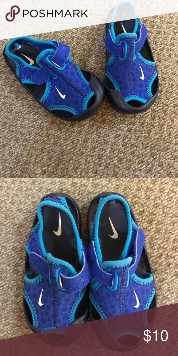 Size 5 infant Nike water shoes . These are the perfect water shoes for the little person they are an infants size 5 . They are blue and teal Nike. Nike Shoes Water Shoes