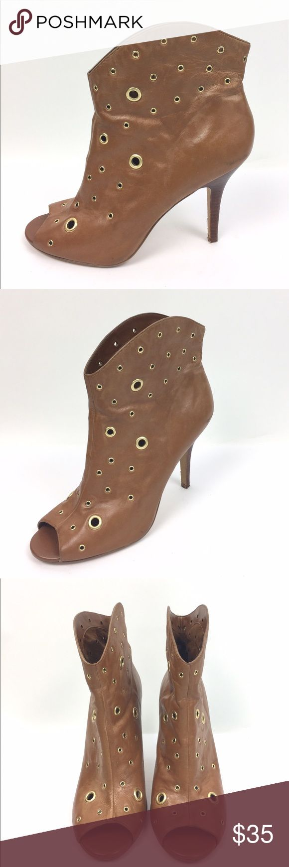 "BCBGeneration Leather Peep Toe Heeled Bootie 11 Brown leather 4"" heeled bootie with peep toe and golden grommets by BCBGeneration. Style name is PL Docker. There is wear to the heel and heel leather but these look nice overall. Size 11 B. A04060 BCBGeneration Shoes Heels"