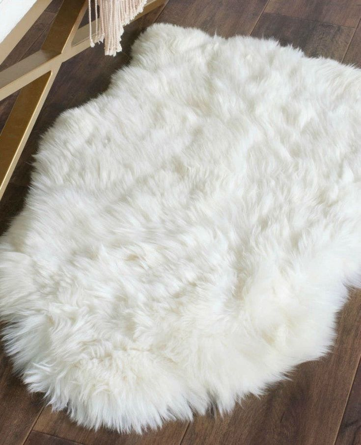Hand-woven of pure sheepskin wool, this rug's superior authentic skins are hand chosen to ensure a natural appearance, and unparalleled quality that will endure for years to come. These long-wearing,