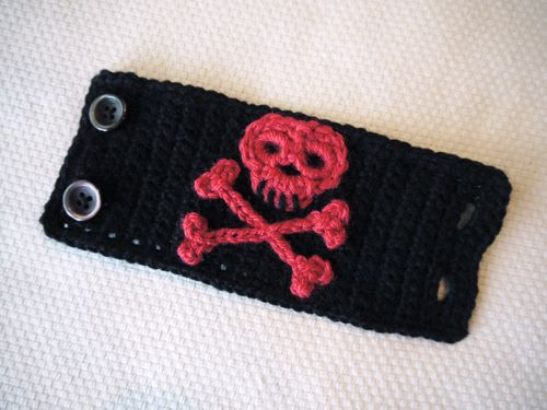 """There are so many crocheted skull & crossbones patterns out there but most of them are very """"meh"""".  NOT THIS ONE.  I love the definition of the eye sockets and sturdiness of the motif!   Created by Heidi at Speckless blog.  THANK YOU!"""