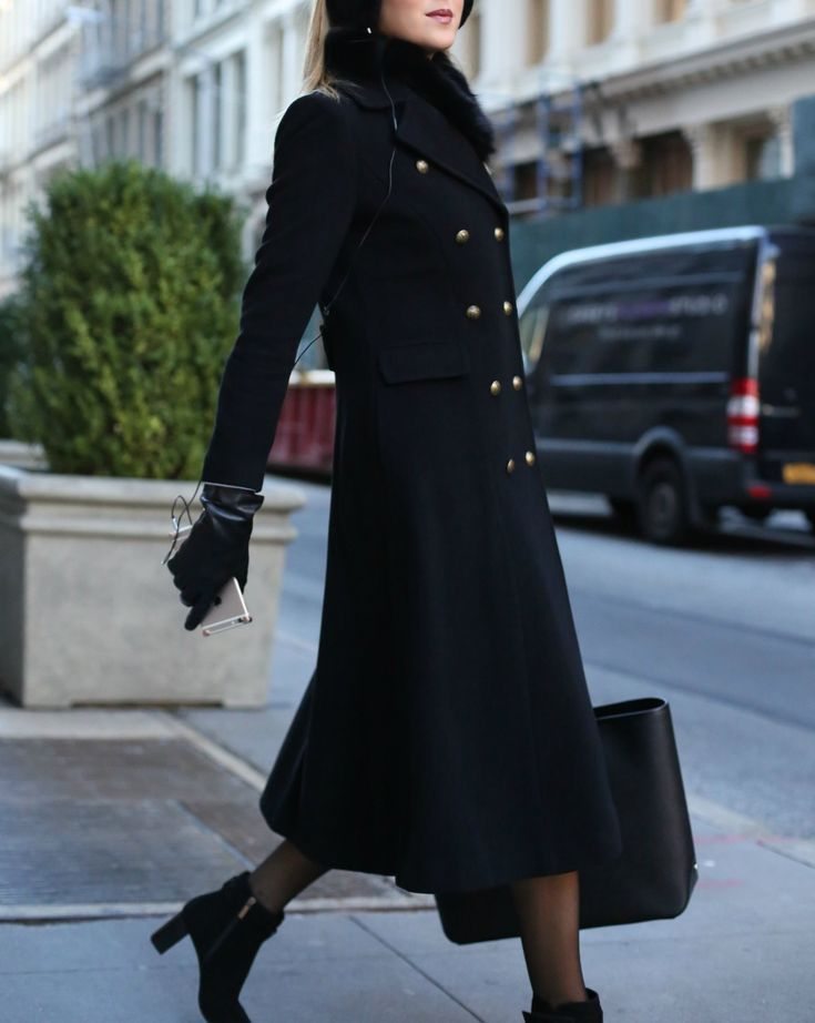 WORKING GIRL WINTER COMMUTE ESSENTIALS   MEMORANDUM // Long double-breasted coat, black heeled booties, black gloves, black fuzzy earmuffs, black oversized tote, fur collar, nude lip {winter style, working girl fashion, professional style, best outfits, what to wear}