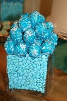 Fill clear centerpieces with candy for a birthday party.
