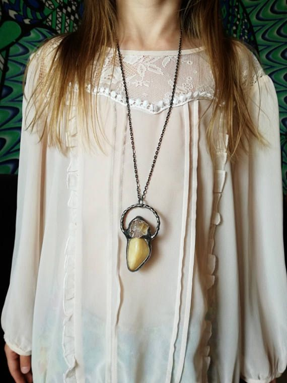 Check out this item in my Etsy shop https://www.etsy.com/listing/532394717/raw-quartz-necklace-quartz-statement