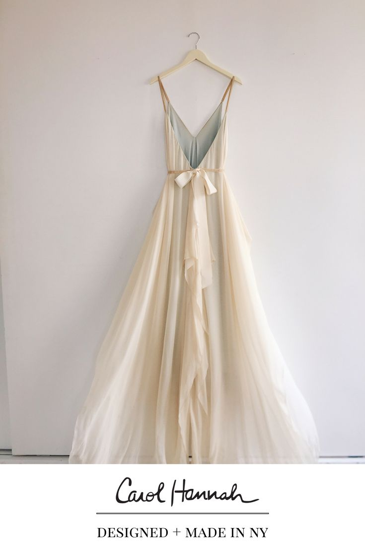 Deep v-neck a-line wedding gown in floaty silk chiffon. Flowy skirt and fun caftan feel, very easy to wear and comfortable. Bridal gown with straps and open back. Long train. Whimsical wedding dress. Wedding ideas for the modern, whimsical, bohemian bride. Nontraditional wedding ideas for ethereal brides' wedding day style. #weddinggowns