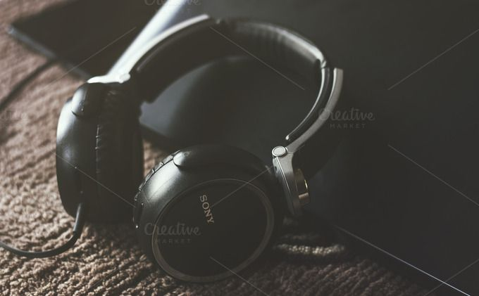 Check out Headphones Inclined on Laptop by Shots By RC on Creative Market
