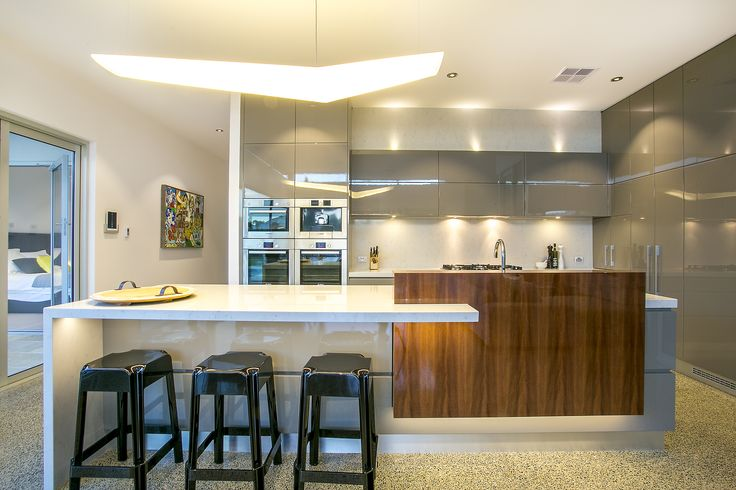 Kitchen of our Unley project - stunning 2pac cabinetry with feature laminate & stone benchtops + polished concrete flooring
