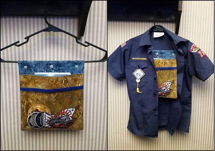 Cub Scout Patch & Handbook keeper I made a pouch that snaps onto my son's uniform hanger. There is a pocket for his handbook, and a clear vinyl pouch for his patches and belt loops he's collected throughout the year. Visit my page on facebook. www.facebook.com/TheCraftyBlackbird