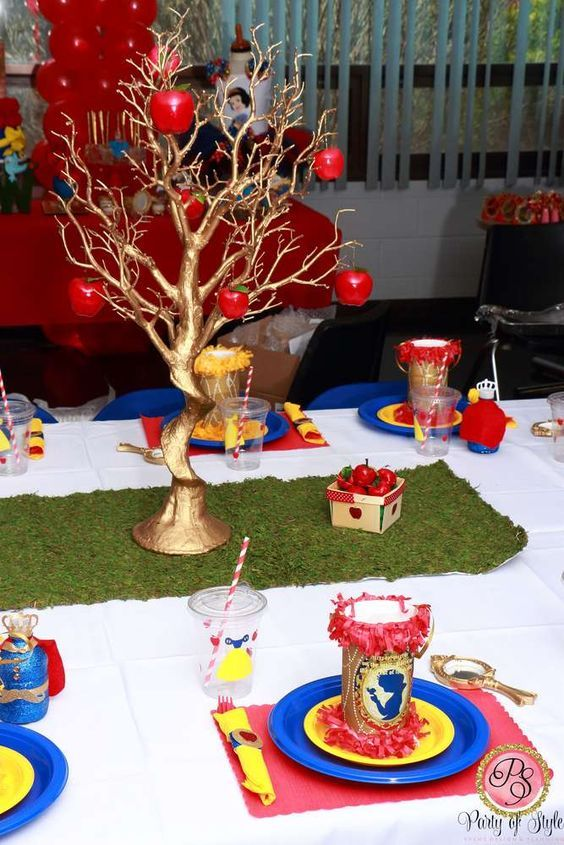 Beautiful gold tree centerpiece for a Snow White birthday party.