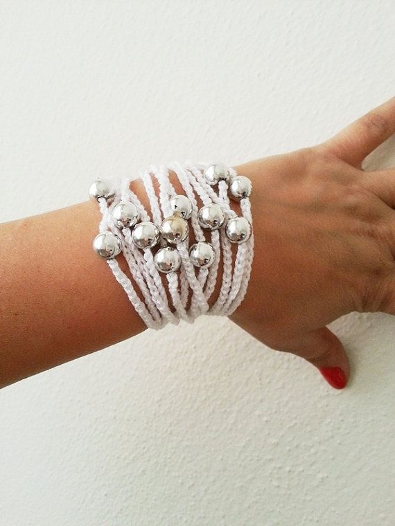 This crocheted rope bracelet is a super cute idea for the summer. Add some silver or gold beads (or color of choice) and you have a brand new beach accessory.