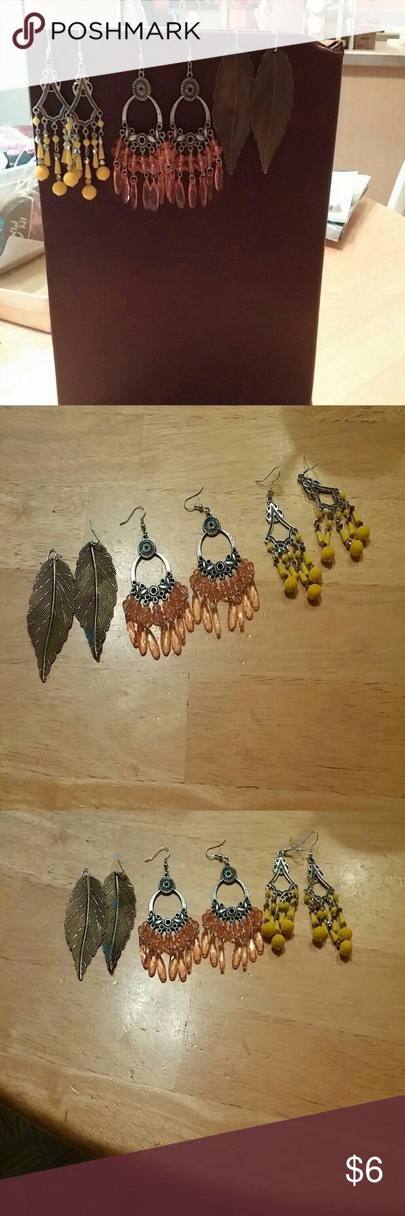 Three pair Costume Earrings 1. Yellow chandelier earrings, 2.peachy color chandelier earrings,  3. Bronze color  Long dangle earrings ?? none Jewelry Earrings