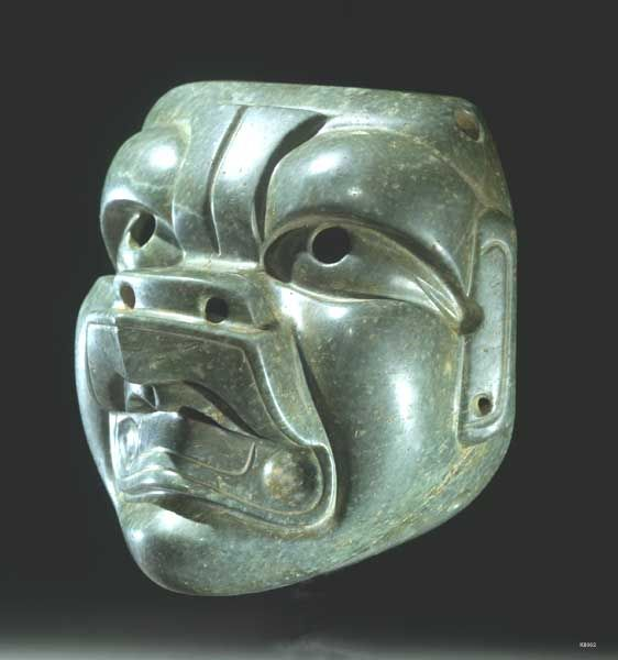 Olmec. Greenstone life size mask with pierced eyes and hollow inside to fit over face.