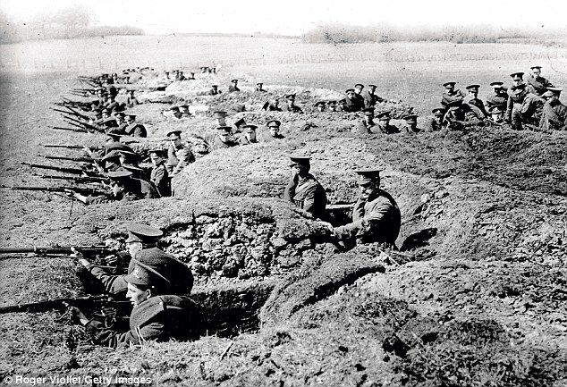 Stalemate and attrition: British soldiers above hold a trench in front of Neuve-Chapelle, ...