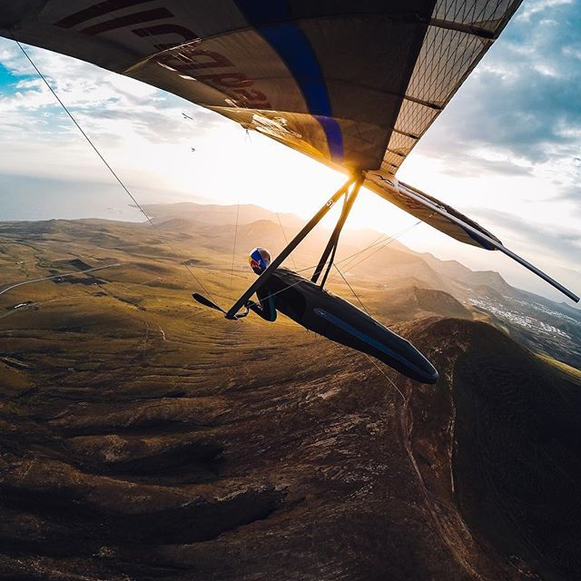 Photo of the Day! Flying into Friday like @matjazklemencic. Have you got big plans this weekend? Share them with us via #GoProAwards click to link! #GoPro #Hangglide #Gliding