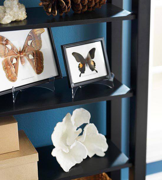 Boxed butterfly prints, pinecones, twine balls, paper boxes -- all are decorative pieces with great stories to tell. Showcase your collections by propping framed illustrations on easels and displaying them on a narrow shelf./