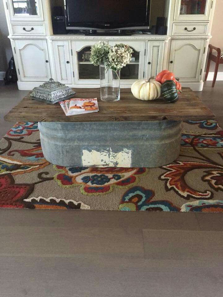 This would be crazy easy to make! Galvanized trough made into a coffee table!   -via Pinterest by Monica Pando